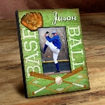 "Our Personalized Kids Sports Frames are the perfect way to showcase your little stars latest sports picture. With a wood-like background and featuring the vibrant colors of each sports playing surface, these personalized frames are perfect for his or her room, as a gift for grandma and grandpa and for a proud parents office. Frames measure 8"" x 10"" and hold a 4"" x 6"" picture. Select sport and personalize with a name up to 12 characters."