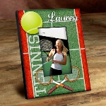 "Great for the tennis fans bedroom or even for the locker room or clubhouse, this personalized tennis picture frame features an old-fashioned look and brightly-colored background. Bearing images of a ball, racquet and court, this whimsical frame is an ideal gift for any ace. Frames measure 8"" x 10"" and hold a 4"" x 6"" picture."