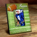 "Our Personalized Kids Sports Frames are the perfect way to showcase your little stars latest sports picture. With a wood-like background and featuring the vibrant colors of each sports playing surface, these personalized frames are perfect for his or her room, as a gift for grandma and grandpa and for a proud parents office. Frames measure 8"" x 10"" and hold a 4"" x 6"" picture."
