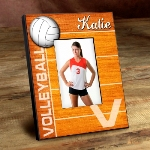 "Bump, Set, Spike! Serve up a smile with our personalized volleyball picture frame. Featuring a gym floor background and large volleyball image, this frame is the perfect way to display your favorite photo. Collegiate-style blue and red font features the name of your favorite volleyball player. Frames measure 8"" x 10"" and hold a 4"" x 6"" picture."