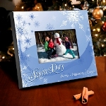 "Our whimsical yet sturdy picture frame looks great on the mantel, the piano, or anywhere you want to show them off! This full color design features a special ""Snow Day"" message and provides plenty of room for names or a short personal sentiment. Frame measures 8"" x 10"" and holds a 4"" x 6"" photo."