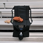 "Eliminate fanny fatigue with our comfy personalized Take a Seat Anywhere Chair, a must-have for any sporting event or anywhere you need a comfortable place to sit. Featuring a cushioned seat and back support, this item folds up for easy carrying. Plenty of pockets in the front and back hold snacks and drinks, including an insulated beverage pocket. A wonderful gift for the sports fan, it can be used any time of year for a more comfortable game experience. Measures 16 1/2"" x 15"" x 1/2""."