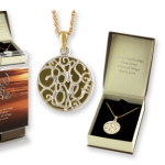 """""""God Is Love"""" consists of an intricate matt silver-finish cut-work pendant uniquely diplaying the words """"God Is Love"""" against an 18 kt. gold finish disc."""