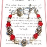Swarovski crystals and bali sterling silver along with glass pearls create this stunning holiday bracelet. Surprise yourself, family or friends. A wish charm hangs next to the toggle as a reminder of all the holiday season. Choose between red(as shown), green or clear crystals.