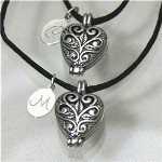 "Share the love you share with your Sister, Best Friend or Maid of Honor with matching Personalized Silver Heart Locket Necklaces. Each heart locket is accompanied by an engraved pendant making a treasured keepsake the two of you can cherish for a lifetime.. Our Engraved Stainless Steel Pendant Necklace measures 1/2"" x 1/2"" with a black necklace measuring 17"". Includes FREE Engraving. Personalize your Silver Filigree Heart Lockets with any single initials. ( ie. C / M )"
