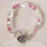 Personalized Awareness Heart Bracelet - Engraved Breast Cancer Awareness Bracelet Show your support for all those fighting this disease and remember those close to your heart who have moved on with this beautiful Personalized Pink Ribbon Awareness Heart Bracelet. A lovely accessory which looks fabulous with any outfit.