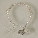 "Your Engraved Bridal Party Bracelet with clear decorative hearts fits a wrist up to 7"". The bracelet is made with clear Swarvoski crystals, Bali silver beads, a silver lobster clasp and includes a dangle heart charm. The bracelet comes arrives in a box with a elegantly printed version of the For My Bridesmaid poem Includes FREE Engraving. Personalize your Bridal Party Bracelet with any initial. ( ie. M )"