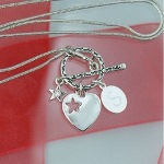 "Elegant and beautiful, this Engraved Time to Shine Necklace makes a great gift for any occasion. Make her feel like she is the shining star in your life when you present her with this adorable Heart and Star Toggle Necklace on her birthday, Valentine's Day, Christmas or just because. Our Engraved Heart & Star Silver-Toned Necklace measures 1 1/2"" in length with a Silver Snake Chain Necklace up to 18 1/2"" Long. Includes FREE Engraving! Engrave your Necklace Charm with any initial."