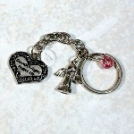 "Welcome a radiant Guardian Angel into your life and let her lovingly protect you each day. This beautiful little angel will watch over you and guide you with its words ""Guardian Angel Protect Me"" engraved on the front and back of its dangling heart. Make this Guardian Angel Keychain a wonderful gift for yourself or someone who truly means the most to you."