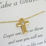 Celebrate a special religious event with our gold toned cross. Layer one, two or three and soon you will see what a charm life can be.