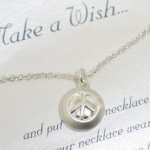 Make a Wish and put on this necklace. When your necklaces wears off your wish will come true. Celebrate a special friendship, graduation celebration or birthday with our trendy Peace sign gift idea.