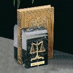 "Designed expressly with the taste of attorneys in mind, this desk set for the legal professional is guaranteed to impress even those of the most sophisticated tastes. Each of the 6"" solid marble bookends is honed from of nature's premier quality black onyx marble. This creates a magnificent and appealing background for displaying the symbolic scales of justice, which are intricate in detail and complimented by a gold plated finish. This set of premium bookends for legal professionals will meet your gift needs for any lawyer or attorney, from the newly graduated to the established practitioner. Decide the precise message you wish to convey and use our free engraving services for displaying it appropriately on a brass plate on one of the bookends."