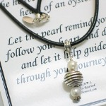 "Follow your hearts and dreams as you journey through your life. The Journey of Life Necklace is a reminder to follow your heart and dreams. 18"" Leather Cord Necklace with Lobster Clasp, two freshwater pearls with a sterling silver center bead. The inspirational gift item arrives in a jewelry box with special message card."
