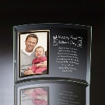 "Surprise a special new dad in your life, with this personalized frame for Fathers Day. This gift is a perfect way to showcase a treasured memory of dad and his new family. This adorable personalized glass photo frame celebrates first-time dads, with the phrase ""Happy First Fathers Day"" along the top of the frame, along with some baby-themed art. This 10"" by 8"" gift for dad leaves plenty of room for a personal message and holds a single, vertical 4"" by 6"" photo."