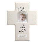 "Ideal for a christening or baptism, this white wooden cross picture frame is the perfect gift for any religious occasion. With an opening for a 3"" x 3"" photo you can inscribe two lines of personalized text to make this an extra special gift that will be treasured by the entire family. Frame measures 12 1/4"" x 9 3/4"" x 3/4""."
