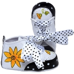 New hand-painted baby shoes offer a whimsical twist on the classic hi-top pre-walker. With special ribbons and laces - and a little extra sparkle - these tiny works of art make an unforgettable and playful keepsake gift.