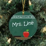 "Create a perfect Personalized Teacher Chalkboard Ornament that looks great every year. Your favorite teacher is sure to enjoy adding this Personalized Teacher Ornament to their Christmas tree and remember their A+ student each and every year. Our Teacher Ceramic Ornament is a flat ornament and measures 2.75"" in diameter. Each Ornament includes a ribbon loop to easily hang from your Christmas tree. Includes FREE Personalization! Personalized your Teacher Ornament with any name."