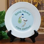 "This Personalized Special Delivery Baby Boy Personalized Plate makes the perfect baby keepsake gift for new parents. Each Ceramic Plate is carefully personalized with the details of your new bundle of joy that creates a treasured keepsake your little boy will cherish forever.  Your Personalized Birth Announcement Baby Plate 7.5"" in Diameter and is dishwasher safe. Easel stand sold separately. Includes FREE Personalization. Personalize your Birth Announcement Plate with the Baby Boys full name, Birth Date, Weight and Length. (ie. Aiden Matthew, 9/1/10, 8lbs 2oz, 21 inches)"