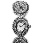 A unique and elegantly detailed brass timepiece dotted with rhinestones! Celebrate a special occasion or holiday with this beautiful and affordable fashion timepiece.
