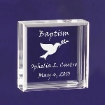 "This Tiny keepsake is decorated with a dove carrying an olive branch, and reads Baptism along the top. A simple way to remember a blessed day. This small keepsake will surely be treasured for many years. These adorable keepsake blocks come with a velvet pouch to keep them dust free. Blocks measure 2 1/2"" x 2 1/2"" and are 1"" thick, so they can stand on their own."
