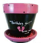 Whimsical flower pots, hand quoted in dozens of different colors and embellishments--just the thing to brighten up your kitchen or deck! They can hold flowers, kitchen utensils, or dog treats. Each has a unique quote that ranges in category from gardening, children, teachers, dogs, humor, family and friendship and more! There is one just right for you!