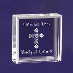 "This Tiny keepsake is decorated with a floral Cross, and reads Bless this Baby along the top. This small keepsake will surely be treasured for many years. These adorable keepsake blocks come with a velvet pouch to keep them dust free. Blocks measure 2 1/2"" x 2 1/2"" and are 1"" thick, so they can stand on their own."