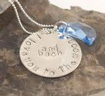 "This is a beautiful sentiment for your loved one...remembering how much we love each other. Hand-forged and stamped sterling silver, with a Swarovski Crystal golden moon. The moon is also available in light sapphire blue, pink, yellow topaz, black and clear crystal (you may choose the color below). Delicately suspended from a sterling rolo chain, the sterling tag and the moon are independent from one another and move separately. On your neck, the moon partially covers the tag. The tag is about a 1"" diameter."
