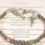 "Our Color Doctor Bracelet makes a great gift idea for a graduating doctor, a way to say thank you for great patient care or as a gift to a physician friend or family member. Each color signifies a special quality. Choose between a medical charm, graduation charm or heart charm. Standard size is 7 3/4"". Shown in Pastel. Also available in vibrant (amethyst, emerald, rose, sapphire)."