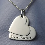 This double heart pendant is perfect for celebrating a special retirement. For all our Years Together is a perfect way to celebrate a special retirement. Engrave front and back of small heart (charm1). And, back of large heart (charm2. Ideas: Personalize small top heart - For All Our Personalize back of larger bottom heart - 1999-2009 (on line 1) Company Name (Line 2)
