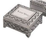 "Enjoy storing jewelry and memorable keepsakes in this gorgeous 4 1/2"" x 5"" rectangular silver box, resting on four legs, with an intricate motif and a large personalized smooth top plate that you can engrave with a name, initials, or personal message. As a gift for a cherished friend, partner, family member, or for yourself, this magnificent box has a classical and timeless appeal."