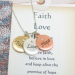 Have faith, believe in love and keep alive the promise of hope is the message of this special necklace. Three toned Faith Love Hope necklace with crystal bead in the center makes a great gift idea for communions, confirmations, sponsor gifts, godmother gifts or inspirational gift ideas.
