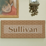 "Our Family Name Wall Canvas can proudly show off the whole family on this attractive Wall Canvas that has been personalized with a family name and up to 12 names repeated through it.  * Includes FREE Personalization  * Up to 12 names!  * Any Family Name  Offered in 5 great colors, this canvas print measures 8""h x 20""w and has gallery wrapped edges so they are prefect to hang with or without a frame."