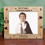 "As your son or daughter grows in the love of God and the church remember these milestone events by creating a Personalized First Communion Picture Frame. Your daughter or son will look great pictured inside this Engraved First Communion Picture Frame. Our Personalized First Communion Wood Picture Frame measures 12 3/4""x 10 3/4"" and holds a 10"" x 8"" photo. Easel back allows for desk display. Includes FREE Personalization! Personalize your First Communion Photo Frame with any name and date. First Communion Frame also available in either horizontal or vertical design format."