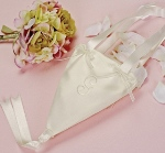 Our Flower Girl Cone takes tradition to new heights. The satin style cone features satin ribbon streamers for the handles and a double ribbon streamer that drops from the bottom of the cone. Organza decorative bows site at the base of the handles on both sides. Available in white and ivory.