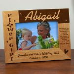 "Our Personalized Flower Girl Wood Picture Frame measures 8 3/4""x 6 3/4"" and holds a 3½""x5"" or 4""x6"" photo. Easel back allows for desk display. Includes FREE Personalization! Personalize your Flower Girl Wood Picture Frame with any Flower Girls Name, Bridal Couples Name and Wedding Date. Please choose between two verses."