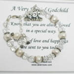 Send wishes of love and happiness to a special godchild any time of year or for a special holiday, religious occasion or celebration. Swarvoski crystals, freshwater pearls and sterling silver with an adjustable clasp and sterling silver godchild charm.