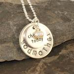 Sterling silver disc with godmother or name on it Sterling silver round faith charm on top Swarovski crystal dangle in any color and/or a freshwater pearl. Please state colors in personalization box otherwise it will come with NO dangles. Includes sterling silver ball chain necklace