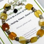 African yellow opal with shell beads with an adjustable sterling silver lobster clasp. Opal is said to be the stone of love with healing power and good luck.