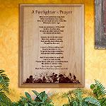 "Now you can tell the hero in your life exactly how you feel on a beautifully Engraved Wood Plaque. This unique gift provides your thoughtful feelings of pride and admiration you feel every day your firefighter goes out to help protect & serve the community. Your Personalized Firefighter Plaque is a perfect gift for Fathers Day, Memorial Day, Birthday and special Anniversary. Your Engraved Firefighters Prayer Plaque measures 7"" x 9"" and includes slotted holes for easy wall mounting. You May Also Like our Black Easel for a great desk display. Includes FREE Personalization. Personalize your Firefighters Prayer Wood Plaque with any 2 line custom message."