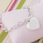 Youll get a designer look at an extraordinary price with our Personalized Heavy Weight Charm Bracelet. Crafted of sturdy, sterling silver-plated links, this trendy bracelet is finished with a classic stand out heart charm and free personalization... great for any gift giving occasion! Includes a free organza gift pouch.