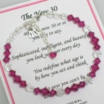"""Celebrate a 40th birthday in an affordable way. Swarvoski crystals and sterling silver with an adjustable clasp and sterling silver """"40"""" charms. Share with a family member, group of friends as they turn 40 or someone special. Remember, aging can be fun..its all in how we act."""