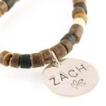 Necklace is made of coco and nut heishi beads and features a hand stamped sterling silver disc with boys name and a leaf motif. If you would like a different one of our symbols we have available, just state that in the personalization area on this page. Great gift idea for a teen age boy, baptism gift, confirmation gift...