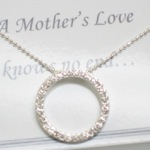 A Mothers Love Knows No End... Pave style crystals on a silver like ball chain. Send mom a gift of love and let her know you love her too.