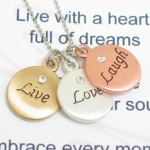 Send an expression of love with the three toned live love laugh necklace. This inspirational gift is sure to be a reminder to live with a heart full of dreams, love from the depth of your soul and to embrace every moment of laughter. Whether giving as a graduation gift, a birthday gift or just as a gift of inspiration, the receiver will be reminded to embrace life.