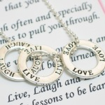 "Let the Live Laugh Love Ring Necklace be a reminder of important things that we should do every day. The Necklace makes a inspirational gift idea for holidays, graduations, birthdays or as a special gift any time of year. 18"" ball chain with silver finishes. Each gift arrives boxed with the Live Laugh Love Poem Card."