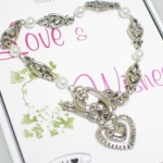 Send Love & Wishes to someone special for their birthday with birthday bracelet. silver toned, pearls with toggle clasp and heart charm