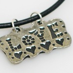 Who doesnt love love? Our Love charm necklace allows to you express yourself...love and be loved.