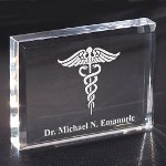 "Show your favorite doctor how thankful you are by giving a Personalized Medical Gift. Each Engraved Medical Keepsake is professionally engraved for optimal presentation. Our exquisitely clear Personalized Keepsake Paperweight makes a perfect selection. This Medical Gift stands 3"" x 4"" with soft edges measuring 1/2"" thick. Includes FREE Personalization! Personalize your Medical Gift with any Doctors Name."