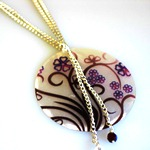 Celebrate a special occasion or celebration or add to your own wardrobe, our Purple Swirl necklace is a great necklace.