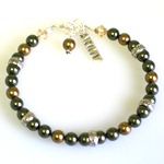 "Our US Army Support Bracelet is a special way to keep a loved on near while serving our country. Made with swarovski pearls, crystals and silver toned beads. The bracelet is 7"" with an adjustable clasp and a sterling silver charm hangs near the toggle. Customize the bracelet with the birth month color of your loved one serving in the army. Choose your special card."